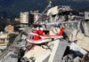 Rescuers search rubble for survivors after motorway bridge collapses in Genoa, Italy leaves at least 26 dead