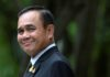 Thai junta leader orders end to army rule but keeps tough powers