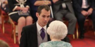 Cave rescuer plays down bravery as he collects award from Queen